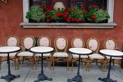 Take a seat (halifaxlight) Tags: poland warsaw oldtown street restaurant seats tables window flowers elegant