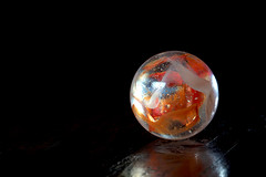 plane variously coloured (JonathanCohen) Tags: sphere locke association depth circle primaryquality perception marble tabletop closeup macro