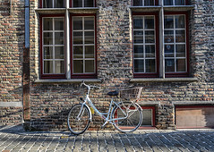 A bicycle on ancient street in Bruges, Belgium (phuong.sg@gmail.com) Tags: belgian ancient antique architecture beautiful belgium bicycle bike building city culture destination downtown europe european exterior famous ghent heritage historic historical history house landmark modern old sightseeing stone tourism town traditional transport transportation travel vacation wall yellow