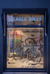 Beagle Bikes (natures-pencil) Tags: wittevrouwenstraat utrecht nederland netherlands night bike bicycle fiets fietsen window display shop lighting colourful lovelycity santos canopy lettering beaglebikes
