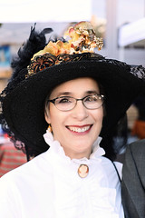 Beautiful Smile (wyojones) Tags: texas galveston dickensonthestrand holidayfestival hat skirt brunette hair girl lady lovely woman beautiful beauty lace smile pretty blouse glasses