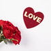 Flower bouquet of red roses with red heart