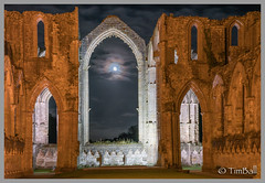 Moonlight through the Eastern Window (timballic) Tags: nationaltrust fountainsabbey northyorkshire floodlit moonlight moonrise eastwindow ruin cistercian chapelofninealtars moon