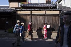 Nameless (Spontaneousnap) Tags: spontaneousnap street city like candid documentary people publicareas lifestyle ricohgr takeabreak afternoon asia kyoto japan tourist kimono cottoncandy
