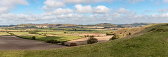 Panorama from White Sheet Downs (Keith in Exeter) Tags: panorama landscape hill downs grass sky view vista whitesheet wiltshire field tree