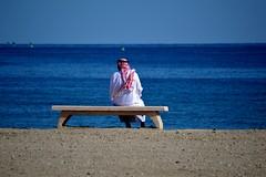 Khor al Fakkan, United Arab Emirates (Seventh Heaven Photography *) Tags: khor al fakkan uae united arab emirates nikon d3200 bench seat man male person sea water ocean sand blue sky
