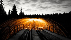 Flaming umbrella (A.K. 90) Tags: lightpainting art artistic orange colorkey nature outside outdoor kunst langzeitbelichtung sonyalpha6000 sigma30mm14 natur landscape railway landschaft stahlwolle brennen burning funken