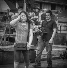 Not Listening (Beegee49) Tags: street man woman filipino filipina flowers carrying talking not listening blackandwhite monochrome bw sony a6000 bacolod city philippines asia