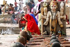 devotion (daniel virella) Tags: red rituals ganges ganga गंगा varanasi वाराणसी uttarpradesh उत्तरप्रदेश india भारत bharat woman altar gaht flowers religion pray people shiva desi picmonkey hinduism
