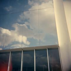 sky reflected (lawatt) Tags: building reflection clouds sky glass clermontferrand france film portra 400 diana f rollfilmweek