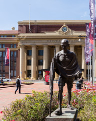 ghandi (Virginia McMillan) Tags: statue statuary art publicart memorial buildings architecture heritage railwaystation summer streeet urban wellington newzealand