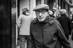 Seek And You Shall Find (Leanne Boulton) Tags: portrait urban street candid portraiture streetphotography candidstreetphotography candidportrait streetportrait eyecontact candideyecontact streetlife old elderly man male face eyes expression mood feeling atmosphere cap glasses tone texture detail depthoffield bokeh naturallight outdoor light shade city scene human life living humanity society culture lifestyle people canon canon5dmkiii 70mm ef2470mmf28liiusm black white blackwhite bw mono blackandwhite monochrome glasgow scotland uk