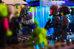 Neon Confrontation (BlueShift 12) Tags: brickarms lego minifigure neon bright lights scifi spacepolice aliens colorful