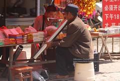 Dayutang, local market, smoking (blauepics) Tags: china yunnan province provinz yuanyang rice terraces reisterrassen terrassen unesco world heritage site weltkulturerbe minorities minoritäten minderheite ethnical ethnische people tribe stamm chinese man mann traditional smoking rauchen pfeife pipe