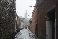 A wet afternoon (lazy south's travels) Tags: cork countycork ireland irish europe european building architecture back alley alleyway urban street scene road fog church spire wet rain storm