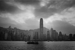 (a.pierre4840) Tags: olympus om2n zuiko 35mm f28 35mmfilm ilford ilfordfp4 fp4 bw blackandwhite monochrome noiretblanc cityscape city hongkong victoriaharbour starferry sky clouds