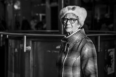 Life (Leanne Boulton) Tags: urban street candid portrait portraiture streetphotography candidstreetphotography candidportrait streetportrait eyecontact candideyecontact streetlife old elderly woman female lady eyes face expression mood feeling emotion winter sunlight cold fur furry hat glasses tone texture detail depthoffield bokeh naturallight outdoor light shade shadow city scene human life living humanity society culture lifestyle people canon canon5dmkiii 70mm ef2470mmf28liiusm black white blackwhite bw mono blackandwhite monochrome glasgow scotland uk