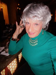 Seventy-One Year Old Woman Trying To Act Seductive (Laurette Victoria) Tags: silver necklace sweater woman laurette bar hotel milwaukee pfisterhotel
