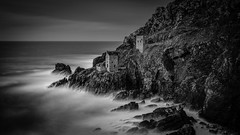 Bleak House (Lloyd Austin) Tags: penzance england unitedkingdom gb bleak house botallack tinmine cornwall coastline coastal coast cliffs mining abandoned exposed decay industrial sea water ocean atlantic dark moody twilight dramatic drama atmospheric sky stormy rocks stones tide black white grey exposure bw bnw blackwhite mono monochrome contrast texture landscape longexposure slow ruins rugged tripod 3lt cablerelease filters seascape sigma1750mm d7200 nikon light blackandwhite crown mines