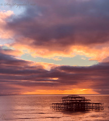 New Years Day Sunset (Pete 5D...©...) Tags: sunset pier brighton reflection sea water sky skies england south coast horizon wind farm windfarm westpier west thegrandhotel dusk evening