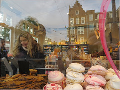 There is a charm about the forbidden that makes it unspeakably desirable. (~Ingeborg~) Tags: meinge amsterdam overtoom stach sweet candy zoet snoep photowalk food reflections macarons girl meisje busy druk people taste proeven chocobars gevuldespeculaas dreams eating