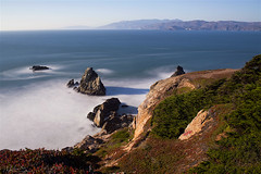 A long exposure on a sunny day (milton sun) Tags: landsend sutrobaths sanfrancisco longexposure seascape bay ngc bayarea wave ocean shore seaside coast california westcoast pacificocean landscape outdoor clouds sky water rock mountain rollinghills sea sand beach cliff nature grass