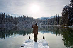 Winterwonderland (Marcel Cavelti) Tags: mk36076bearb crestasee winter winterwonderland lake mirror reflection woman photographer steg forest snow trees water explore