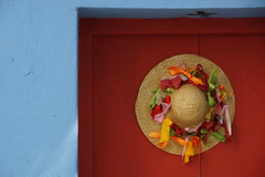 Wherever I Hang My Hat (steve_whitmarsh) Tags: greece skiathos skiathostown building architecture door colour red orange blue pink green topic abigfave