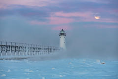 Blue Monday (Aaron Springer) Tags: michigan northernmichigan lakemichigan thegreatlakes manisteenorthpierheadlight ice snow moon moonset clouds lighthouse pier catwalk outdoor nature bluemonday