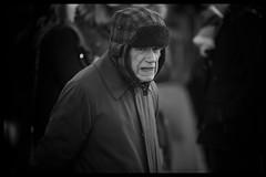 Feeling the chill (Frank Fullard) Tags: elderly old man older frankfullard fullard candid street portrait cold chilly cool weather warm monochrome black white blanc noir cap head