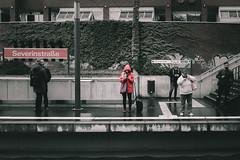 Red Hood (Zesk MF) Tags: hood street zesk cologne candid haltestelle smoking woman x100f fuji people strase waiting