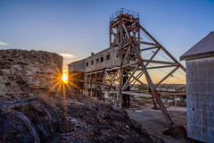 The Old Juction Mine, Broken Hill (*ScottyO*) Tags: brokenhill nsw australia mine bhp urbex old abandoned history mining building shed sun sunset sunburst sunbeam evening blue yellow iron steel silve lines stone outback