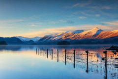 Sunrise over Derwent Water (gmorriswk) Tags: keswick england unitedkingdom gb lake district derwent water derwentwater mountains mountain snow sunrise reflection reflections formatt hitech firecrset morning calm frozen fence feelingscolour breath taking landscapes