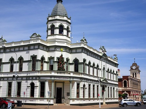 Forbes. Old gold mining town with grand buildings. Nearest is the 1891 Town Hall. Beyond is the 1881 built French Renaissance style Post Office designed by colonial architect James Barnet.