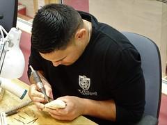 Rotorua. Young Maori man learning the delicate art of traditonal carving at Whakarewarewa Living Maori Village. (denisbin) Tags: taranaki mountegmont mounttaranaki maori youth man maoriman whakarewarewa tepuia carving maoricarving