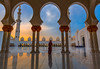 Woman-sunset-gazing-under-Grand-Mosque-archways.jpg (yobelprize) Tags: illuminate east sunsetsky yobelmuchang sheikh tourist emirates abayafashion religious united abudhabi worship islam muslim zayed sunset architecture dome nightphotography abaya temple traditional abu famous redpurse domes dhabi grand robes culture landmark reflections pillars gold silhouette reflection middle islamic religion longexposure blue hood uae mosque jedi yobel symmetry illuminated grandmosque arabic abayawoman arab arches