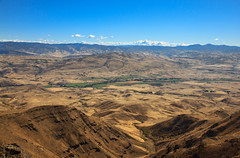View From Squaw Butte (http://fineartamerica.com/profiles/robert-bales.ht) Tags: forupload gemcounty haybales idaho landscape people photo places projects scenic states mountain emmett sweet storm squawbutte farm rollinghills idahophotography treasurevalley northamericanphotography clouds spring emmettvalley emmettphotography trees sceniclandscapephotography thebutte canonshooter beautiful sensational awesome magnificent peaceful surreal sublime magical spiritual inspiring inspirational wow robertbales town butte gem