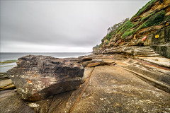 Don't be here at high tide (JustAddVignette) Tags: australia cliff clouds cloudy copyspace deewhy drizzle headland landscapes longexposure newsouthwales northernbeaches ocean rocks seascape seawater sky sydney water waves