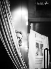 curtain.call (grizzleur) Tags: eyes guy man dude hide hidden fabric flag lines portrait street candid olympus omd olylove olympusomdem10mkii olympusm45mmf18 olympusmzuiko45f18 light subway bw mono monochrome