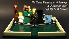 The Three Visitations of Scrooge: A Christmas Carol Pop-Up Book Insert (MCLegoboy) Tags: mclegoboy lego christmas moc myowncreation mod modification 21315 ideas popup book three visitation scrooge achristmascarol past present future yettocome grandfather clock table dinner turkey goose graveyard tombstone