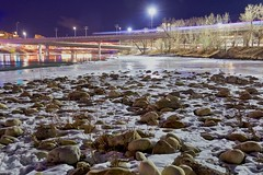 Icy Bow River (John Andersen (JPAndersen images)) Tags: bowriver bridge calgary city night rocks snow