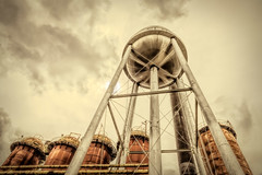 Sloss Furnaces Water Tower and Silos (gerrydanielphotography) Tags: slossfurnaces buildings decay industrial pipes rust silos tower watertower birmingham alabama national historic landmark