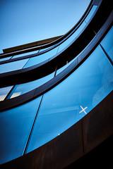 Blue Lines (iamunclefester) Tags: münchen munich street autumnstreetphotos autumn blue lines curves curvy windows windowpane massiveattack abstract toned sky shop shopwindow shopping facade lights