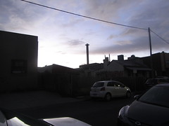Evening Sky! Abbotsford, Melbourne (d.kevan) Tags: buildings backstreets chimneys roofs clouds outlines cars abbotsford melbourne dusk verandahs fences graffitti plants grass trees signs