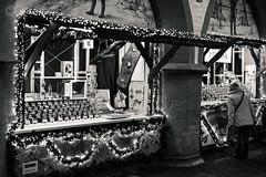 Window Shopping (dlerps) Tags: amount centralgermany de daniellerps eu europa europe fullframe germany harz lerps lowersaxony mitteldeutschland niedersachsen norddeutschland northerngermany sony sonyalpha sonyalpha99ii sonyalphaa99ii lerpsphotography goslar market weihnachtsmarkt christmasmarket xmas holiday streetphotography monochrome blackwhite bw lights lichterkette lightchain shopping