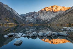 Convict Blue and Red (Kirk Lougheed) Tags: california convictlake easternsierra laurelmountain monocounty mountmorrison usa unitedstates alpenglow autumn dawn fall lake landscape mountain outdoor reflection rock sunrise water