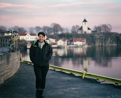 Visiting Brevik (Geir Bakken) Tags: portrait perfectbeauty woman church city pier asian thai norway mediumformat mamiya mamiyarb67 120 analog analogue analogphotography film filmisnotdead filmphotography ilovefilm fujipro400h fuji beautiful beauty