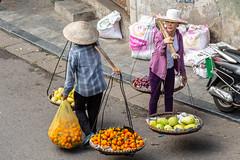 Street sellers near Long Bien bridge (DAVEBARTLETT2) Tags: vietnam hanoi ga long street market seller harness fruit