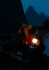 Fisherman (Rod Waddington) Tags: china chinese yangshuo li river guangxi karst mountains lamp light nightphotography night man outdoor