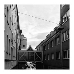 Connections (Thomas Listl) Tags: thomaslistl blackandwhite biancoenegro noiretblanc monochrome square grey dark mood atmosphere architecture würzburg urban city sky bridge facade buildings